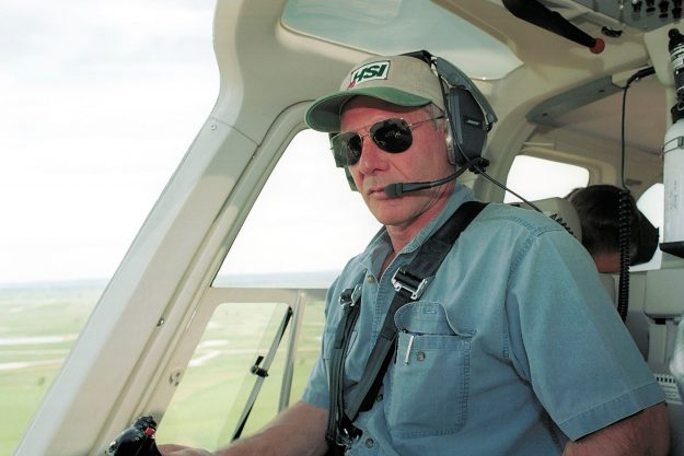 Harrison Ford narrowly avoids another crash as he flies low over a plane